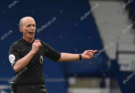 Referee Mike Dean reacts during the English Premier League soccer match between West Bromwich Albion and Liverpool at the Hawthorns stadium in West Bromwich, England
