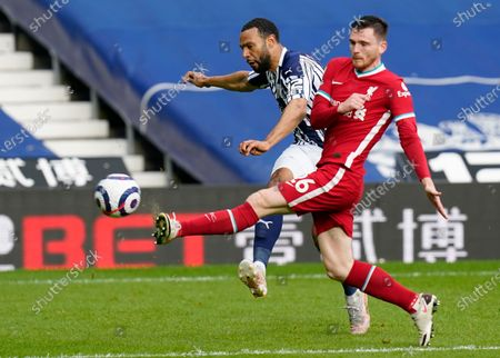 Stock Image of Liverpool's Andrew Robertson, right, tries to block a shot from West Bromwich Albion's Matt Phillips during the English Premier League soccer match between West Bromwich Albion and Liverpool at the Hawthorns stadium in West Bromwich, England