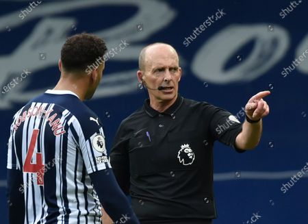 Referee Mike Dean, right, speaks with West Bromwich Albion's Hal Robson-Kanu during the English Premier League soccer match between West Bromwich Albion and Liverpool at the Hawthorns stadium in West Bromwich, England