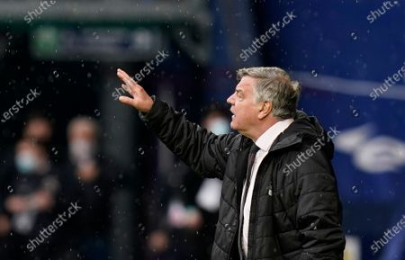 Stock Image of West Bromwich Albion's manager Sam Allardyce gives instructions to his players during the English Premier League soccer match between West Bromwich Albion and Liverpool at the Hawthorns stadium in West Bromwich, England