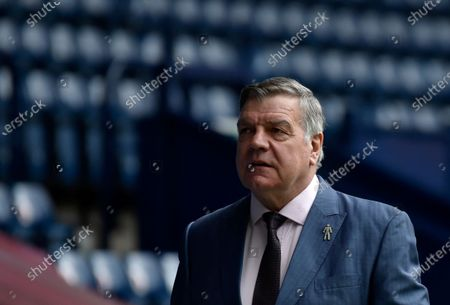 West Bromwich Albion's manager Sam Allardyce walks before the English Premier League soccer match between West Bromwich Albion and Liverpool at the Hawthorns stadium in West Bromwich, England