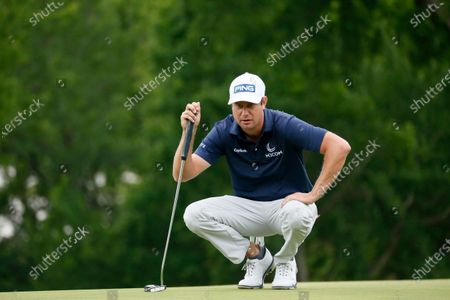Harris English prepares to putt on the first green during the final round of the AT&T Byron Nelson golf tournament in McKinney, Texas