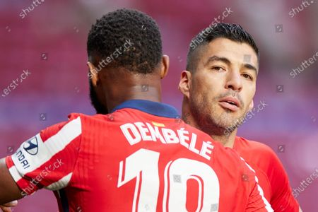Luis Suarez and Moussa Dembele of Atletico de Madrid