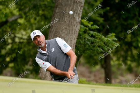 Matt Kuchar chips onto the first green during the final round of the AT&T Byron Nelson golf tournament in McKinney, Texas
