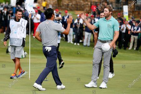Kyoung-Hoon Lee, left, of South Korea, and Sam Burns, right, congratulate each other on the 18th green after their final round of the AT&T Byron Nelson golf tournament in McKinney, Texas, . Lee won the tournament