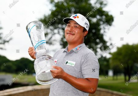 Lee, of South Korea, holds the Champions Trophy after winning the AT&T Byron Nelson golf tournament in McKinney, Texas