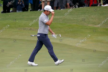Kyoung-Hoon Lee, of South Korea, acknowledges cheers as he walks onto the 18th green during the final round of the AT&T Byron Nelson golf tournament in McKinney, Texas, . Lee won the tournament
