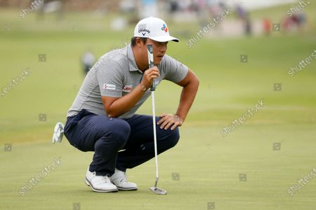 Kyoung-Hoon Lee, of South Korea, prepares to putt on the first green during the final round of the AT&T Byron Nelson golf tournament in McKinney, Texas