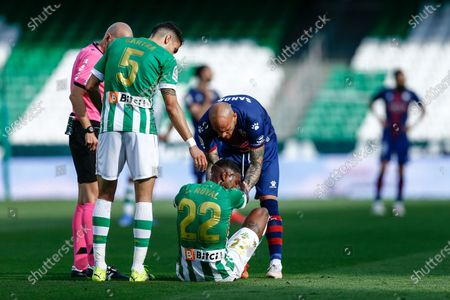 Stock Picture of Emerson Royal and Marc Bartra of Real Betis and Sandro Ramirez of SD Huesca
