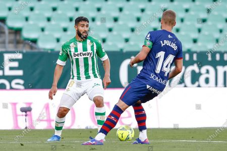 Nabil Fekir of Real Betis and Jorge Pulido of SD Huesca