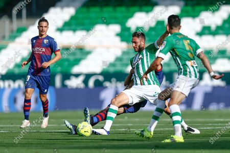 Victor Ruiz and Marc Bartra of Real Betis and Jaime Seoane and David Ferreiro of SD Huesca