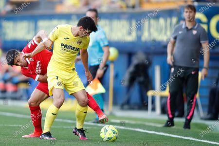 Gerard Moreno of Villarreal CF and Marcos Acuna of Sevilla FC