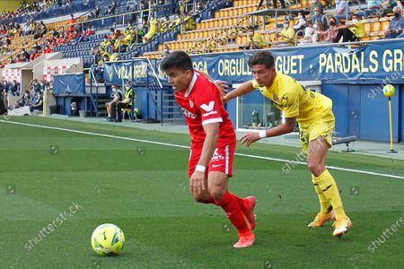 Marcos Acuna of Sevilla FC and Yeremi Pino of Villarreal CF