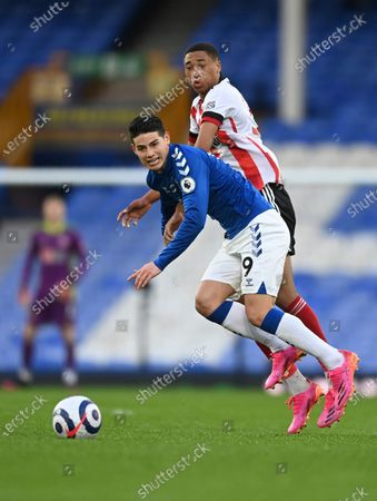 Everton's James Rodriguez, left, and Sheffield United's Daniel Jebbison challenge for the ball during the English Premier League soccer match between Everton and Sheffield United at Goodison Park in Liverpool, England