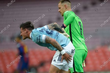 Stock Photo of Santi Mina of RC Celta and Marc-Andre Ter Stegen of FC Barcelona