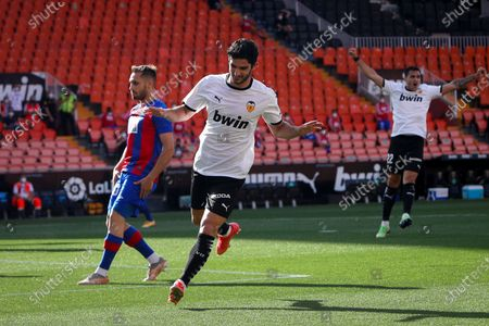 Valencia's Goncalo Guedes celebrates after scoring a goal during the Spanish LaLiga soccer match between Valencia CF and SD Eibar held at Mestalla stadium in Valencia, eastern Spain, 16 May 2021.