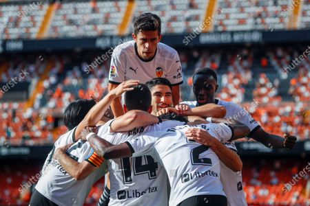 Valencia's Goncalo Guedes (2-R) celebrates with teammates after scoring a goal during the Spanish LaLiga soccer match between Valencia CF and SD Eibar held at Mestalla stadium in Valencia, eastern Spain, 16 May 2021.