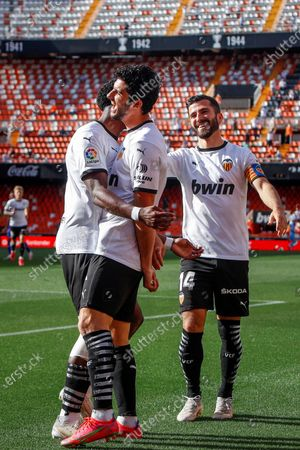 Valencia's Goncalo Guedes (C) celebrates with teammates after scoring a goal during the Spanish LaLiga soccer match between Valencia CF and SD Eibar held at Mestalla stadium in Valencia, eastern Spain, 16 May 2021.