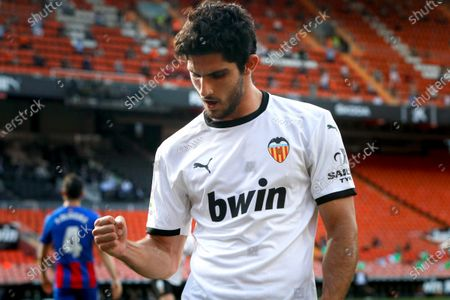 Stock Photo of Valencia's Goncalo Guedes celebrates after scoring a goal during the Spanish LaLiga soccer match between Valencia CF and SD Eibar held at Mestalla stadium in Valencia, eastern Spain, 16 May 2021.