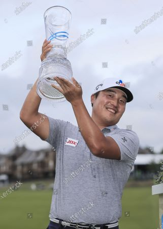 Kyoung-hoon Lee of South Korea smiles as he hoists the winners trophy after the fourth round of the AT&T Byron Nelson golf tournament at TPC Craig Ranch in McKinney, Texas, USA, 16 May 2021. The tournament is being played 13 May through 16 May.