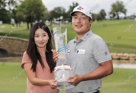 Kyoung-hoon Lee of South Korea (R) and his wife Joo Yeon Yu (L) pose with the winners trophy after the fourth round of the AT&T Byron Nelson golf tournament at TPC Craig Ranch in McKinney, Texas, USA, 16 May 2021.
