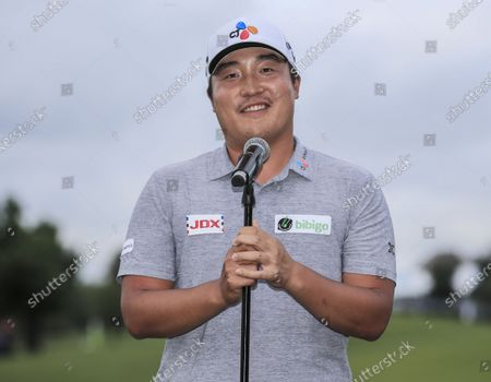 Stock Image of Kyoung-hoon Lee of South Korea speaks during the trophy ceremony after winning the AT&T Byron Nelson golf tournament at TPC Craig Ranch in McKinney, Texas, USA, 16 May 2021.