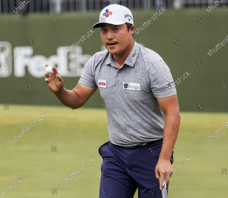 Stock Picture of Kyoung-hoon Lee of South Korea holds his ball after putting for birdie on the seventeenth green during the fourth round of the AT&T Byron Nelson golf tournament at TPC Craig Ranch in McKinney, Texas, USA, 16 May 2021. Lee won the tournament.