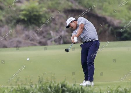 Kyoung-hoon Lee of South Korea hits his second shot on the fifth hole during the third round of the AT&T Byron Nelson golf tournament at TPC Craig Ranch in McKinney, Texas, USA, 16 May 2021. The tournament is being played 13 May through 16 May.
