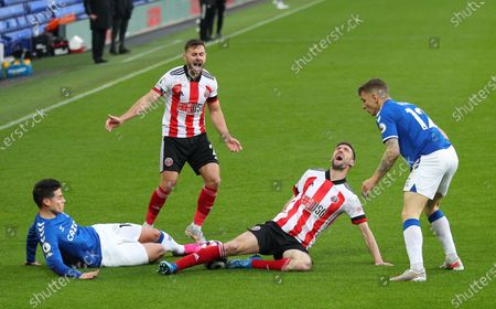 Stock Picture of James Rodriguez (L) of Everton in action against Chris Basham (2-R) of Sheffield during the English Premier League soccer match between Everton FC and Sheffield United in Liverpool, Britain, 16 May 2021.