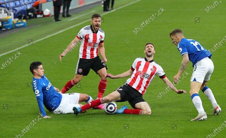 Stock Photo of James Rodriguez (L) of Everton in action against Chris Basham (2-R) of Sheffield during the English Premier League soccer match between Everton FC and Sheffield United in Liverpool, Britain, 16 May 2021.