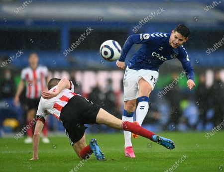 James Rodriguez (R) of Everton in action during the English Premier League soccer match between Everton FC and Sheffield United in Liverpool, Britain, 16 May 2021.