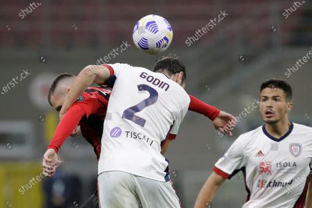 Cagliari's Diego Godin, right, goes for the header with AC Milan's Ante Rebic during a Serie A soccer match between AC Milan and Cagliari, at the San Siro stadium in Milan, Italy