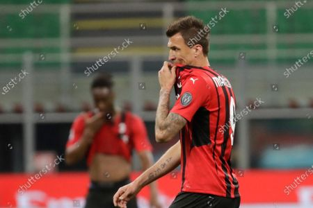Milan's Mario Mandzukic gestures at the end of a Serie A soccer match between AC Milan and Cagliari, at the San Siro stadium in Milan, Italy