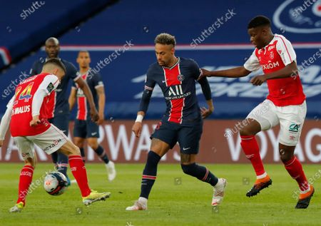 PSG's Neymar, centre, vies for the ball with Reims' Mathieu Cafaro, left, and Reims' Ghislain Konan, right, during the French League One soccer match between Paris Saint-Germain and Reims at the Parc des Princes stadium in Paris, France