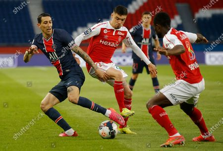 PSG's Angel Di Maria, left, competes with Reims' Mathieu Cafaro, centre, and Reims' Ghislain Konan, right, during the French League One soccer match between Paris Saint-Germain and Reims at the Parc des Princes stadium in Paris, France