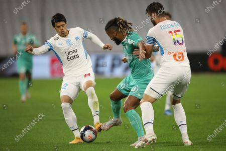 Marseille's Hiroki Sakai and Angers' Lois Diony, center, battle for the ball during the French League One soccer match between Marseille and Angers at the Velodrome stadium in Marseille, southern France
