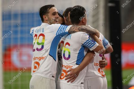 Marseille players celebrate Marseille's Arkadiusz Milik's second goal during the French League One soccer match between Marseille and Angers at the Velodrome stadium in Marseille, southern France