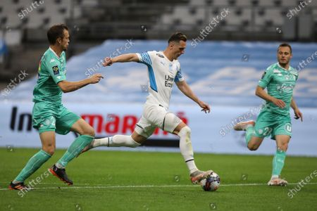 Marseille's Arkadiusz Milik shoots the ball to score his side's second goal during the French League One soccer match between Marseille and Angers at the Velodrome stadium in Marseille, southern France
