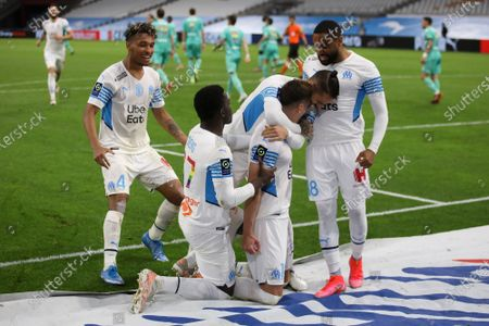 Marseille players celebrate Arkadiusz Milik's penalty during the French League One soccer match between Marseille and Angers at the Velodrome stadium in Marseille, southern France