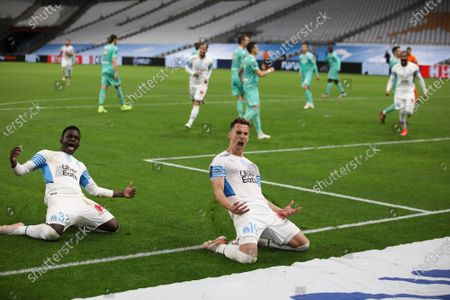 Marseille's Arkadiusz Milik celebrates scoring a penalty during the French League One soccer match between Marseille and Angers at the Velodrome stadium in Marseille, southern France