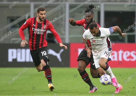 Cagliari's Joao Pedro (R) challenges for the ball with  AC Milan's Franck Kessie (C) and his teammate Theo Hernandez  during the Italian serie A soccer match between AC Milan and Cagliari at Giuseppe Meazza stadium in Milan, Italy, 16 May 2021.