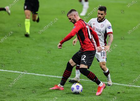 Ante Rebic of AC Milan fights for the ball against Nahitan Nandez of Cagliari Calcio