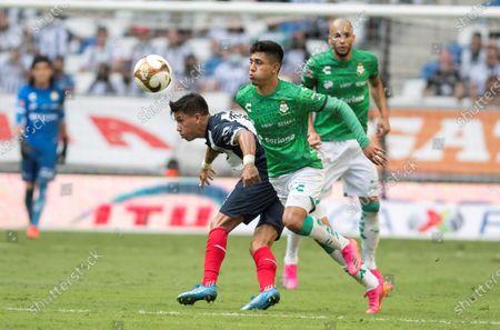 Maximiliano Meza (L) of Monterrey disputes the ball with Omar Campos (R) of Santos Laguna during a Clausura 2021 quarterfinals soccer match between Monterrey and Santos Laguna at the BBVA stadium in Monterrey, Mexico, 16 May 2021.