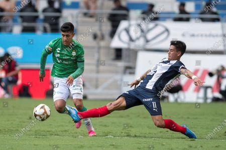 Stock Photo of Maximiliano Meza (R) of Monterrey disputes the ball with Omar Campos (L) of Santos Laguna during a Clausura 2021 quarterfinals soccer match between Monterrey and Santos Laguna at the BBVA stadium in Monterrey, Mexico, 16 May 2021.