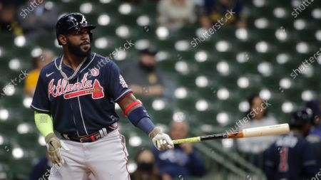 Atlanta Braves' Marcell Ozuna bats during the first inning of a baseball game against the Milwaukee Brewers, in Milwaukee