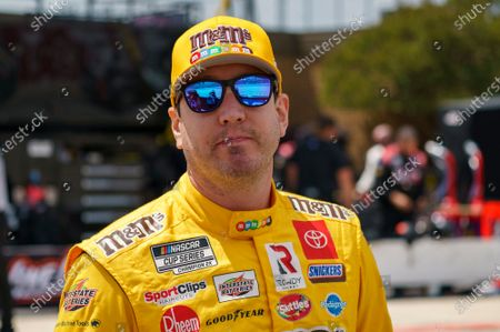 Stock Picture of Kyle Busch looks on prior to a NASCAR Cup Series auto race at Dover International Speedway, in Dover, Del