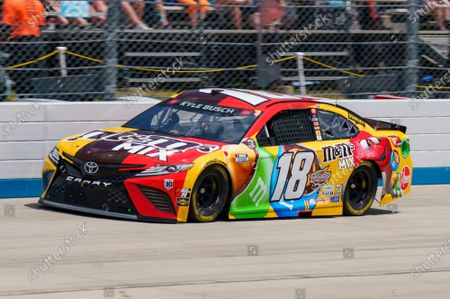 Stock Photo of Kyle Busch in action during a NASCAR Cup Series auto race at Dover International Speedway, in Dover, Del