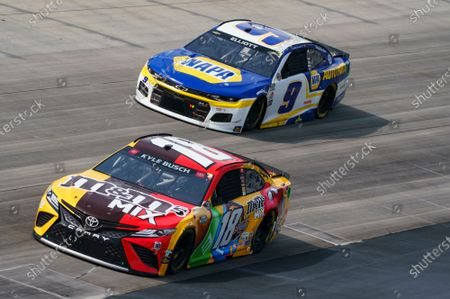 Kyle Busch, left, in action against Chase Elliott, right, during a NASCAR Cup Series auto race at Dover International Speedway, in Dover, Del