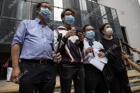 Hong Kong democracy activists Richard Choi (L) and Figo Chan (2L), together with former lawmakers Albert Ho (2R) and Emily Lau (R), stand outside the District Court in Hong Kong, China, 17 May 2021. Ho and other pro-democracy activists are on trial for 'incitement to knowingly taking part in an unauthorized assembly' on 01 October 2019.