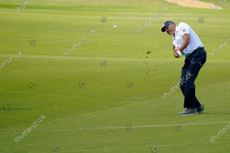 Matt Kuchar hits off the 18th fairway during the third round of the AT&T Byron Nelson golf tournament in McKinney, Texas